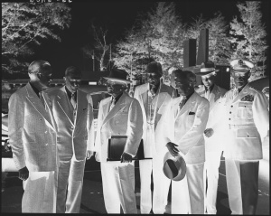 Photograph_of_President_Truman_with_his_some_of_his_top_advisers,_upon_his_return_to_Washington_from_the_Wake_Island..._-_NARA_-_200236