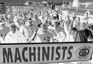 Boeing machinists march from company's Renton, Washington factory to their union hall to vote on the company's final contract offer